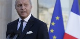 French Foreign Affairs Minister Fabius speaks to journalists following a meeting at the Elysee Palace in Paris